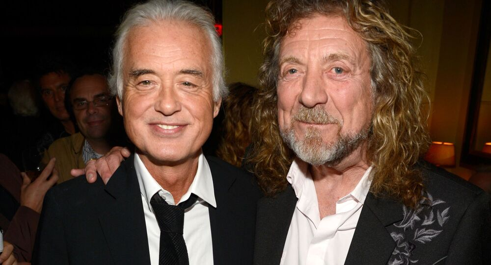 NEW YORK, NY - OCTOBER 09: (Exclusive Coverage) Jimmy Page and Robert Plant attend the after party for Led Zeppelin: Celebration Day at Monkey Bar on October 9, 2012 in New York City