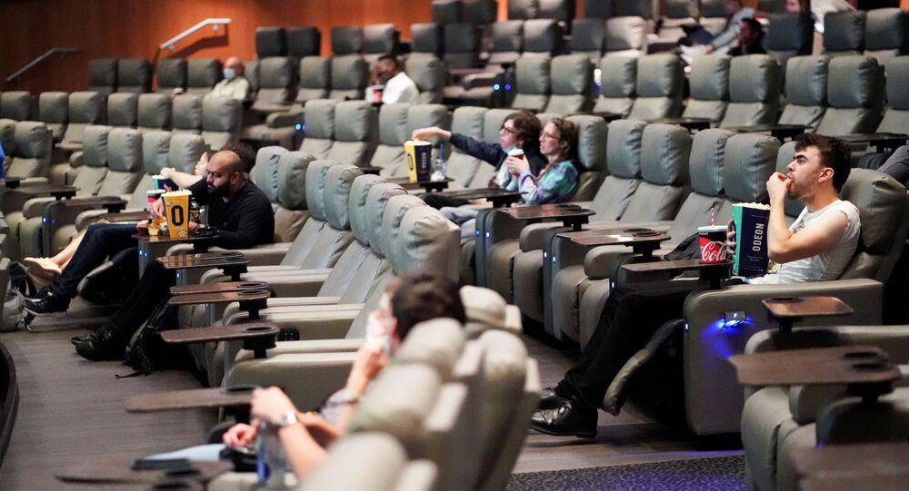 People take their seats inside the Odeon Luxe Leicester Square cinema, on the opening day of the film Tenet, amid the coronavirus disease (COVID-19) outbreak, in London, Britain, August 26, 2020