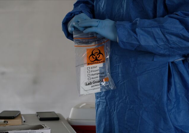 A biohazard bag is used for containing a specimen for a coronavirus disease (COVID-19) test