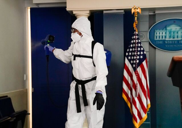 A member of the White House cleaning staff sprays the press briefing room the evening of U.S. President Donald Trump's return from Walter Reed Medical Center after contracting the coronavirus disease (COVID-19), in Washington, U.S., October 5, 2020.