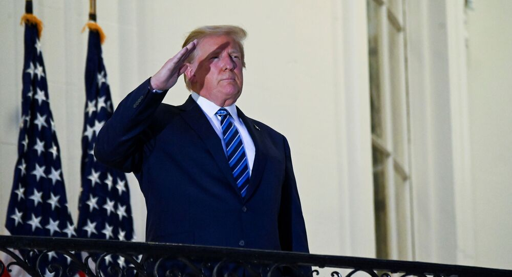U.S. President Donald Trump salutes as he poses without a face mask on the Truman Balcony of the White House after returning from being hospitalized at Walter Reed Medical Center for coronavirus disease (COVID-19) treatment, in Washington, U.S. October 5, 2020.