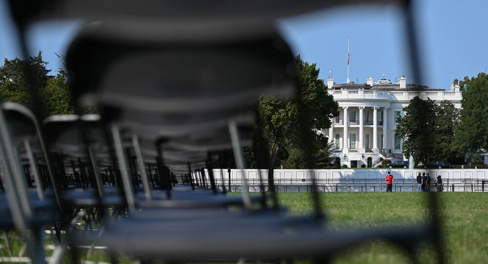 Empty chairs representing a fraction of the 200,000 U.S. lives lost to coronavirus disease (COVID-19) are seen during the National COVID-19 Remembrance near the White House in Washington, U.S. October 4, 2020.