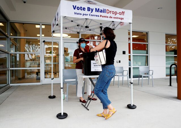 Katie Tricarico prepares to cast her mail-in voter ballot the last day of early voting for the U.S. presidential election at the C. Blythe Andrews, Jr. Public Library in East Tampa, Florida, U.S., August 16, 2020.
