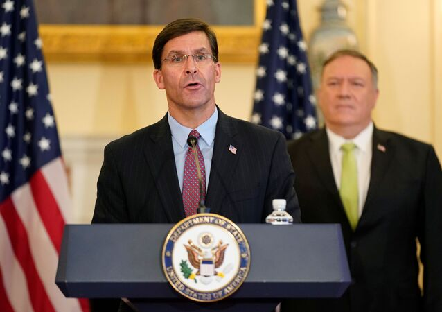 U.S. Defense Secretary Mark Esper speaks next to U.S. Secretary of State Mike Pompeo during a news conference to announce the Trump administration's restoration of sanctions on Iran, at the U.S. State Department in Washington, U.S., September 21, 2020.