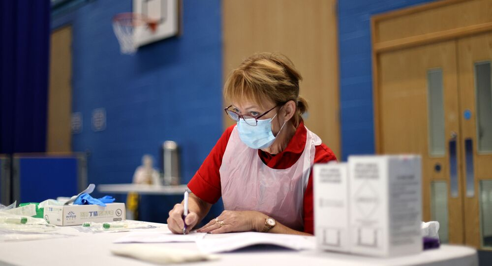A health worker prepares before conducting tests for COVID-19 at a Stoke-on-Trent City Council facility at Fenton Manor Sports Complex amid the outbreak of the coronavirus disease (COVID-19), in Fenton, Stoke-on-Trent Britain October 6, 2020.