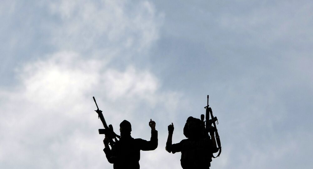 Palestinian Islamic Jihad militants hold up their guns during a rally to mark the 25th anniversary of the movement's foundation in Gaza City, on October 4, 2012.