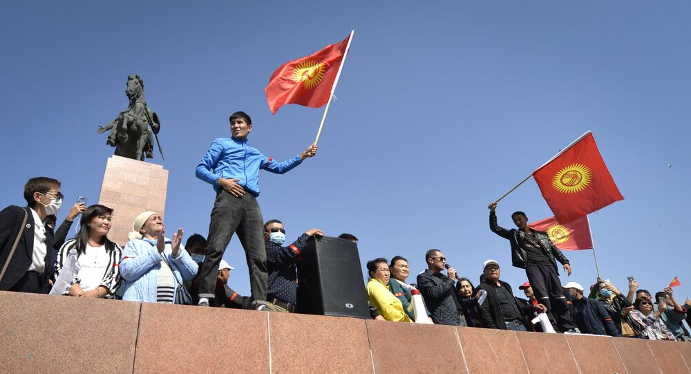 People protest during a rally against the results of a parliamentary vote in Bishkek, Kyrgyzstan, Monday, Oct. 5, 2020