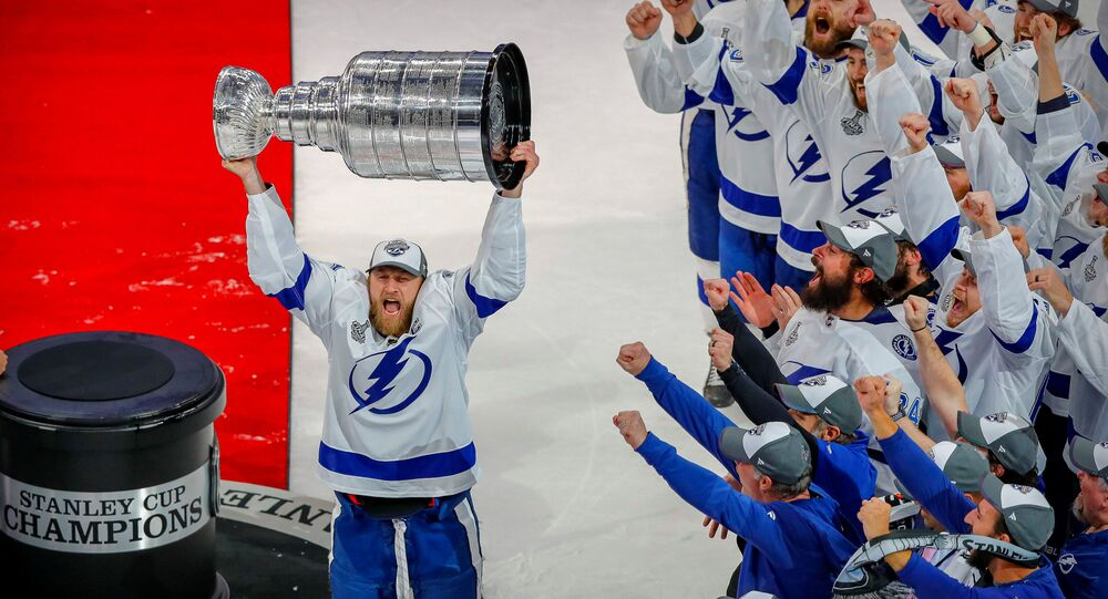 Oct 4, 2020; Tampa, Florida, USA; Tampa Bay Lightning player Steven Stamkos hoists the Stanley Cup as the team is congratulated by the Tampa Bay Buccaneers in the first quarter of a NFL game against the Los Angeles Chargers at Raymond James Stadium. Mandatory Credit: Kim Klement-USA TODAY Sports