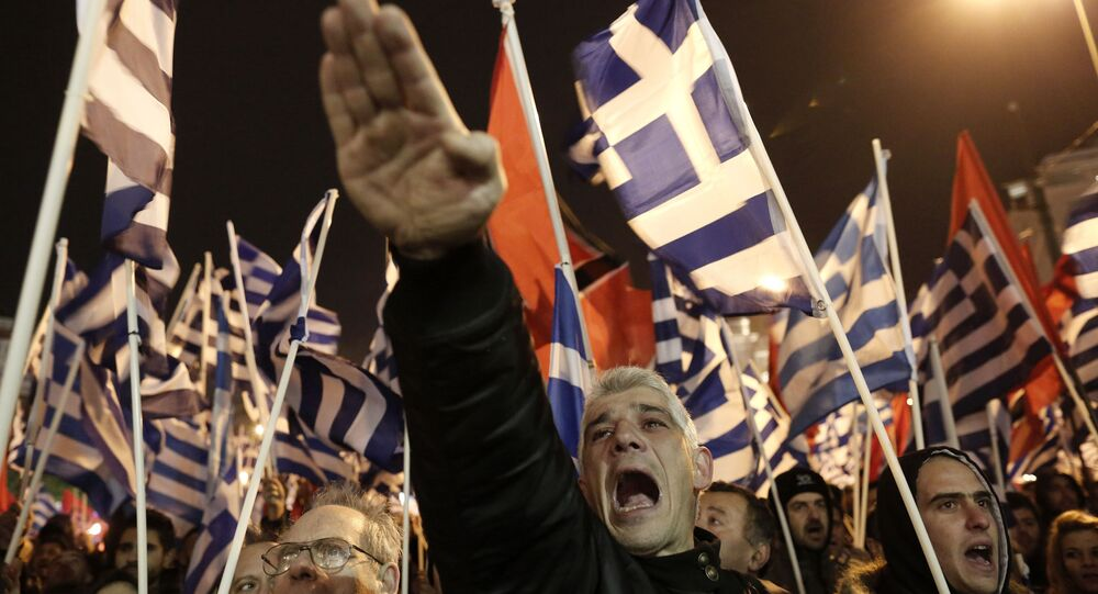 A supporter of Greece's right-wing party Golden Dawn raises his hand in a Nazi-style salute during a rally in Greece in 2014