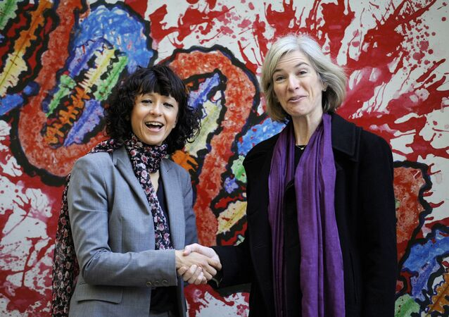FILE PHOTO: French microbiologist Emmanuelle Charpentier (L) and professor Jennifer Doudna of the U.S. pose for the media during a visit to a painting exhibition by children about the genome, at the San Francisco park in Oviedo, SPAIN, October 21, 2015