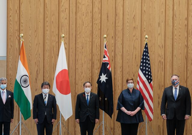 (L-R) India's Foreign Minister Subrahmanyam Jaishankar, Japan's Foreign Minister Toshimitsu Motegi, Japan's Prime Minister Yoshihide Suga, Australia's Foreign Minister Marise Payne and US Secretary of State Mike Pompeo pose for photographs before a Quad Indo-Pacific meeting at the prime minister's office in Tokyo on October 6, 2020 in Tokyo.