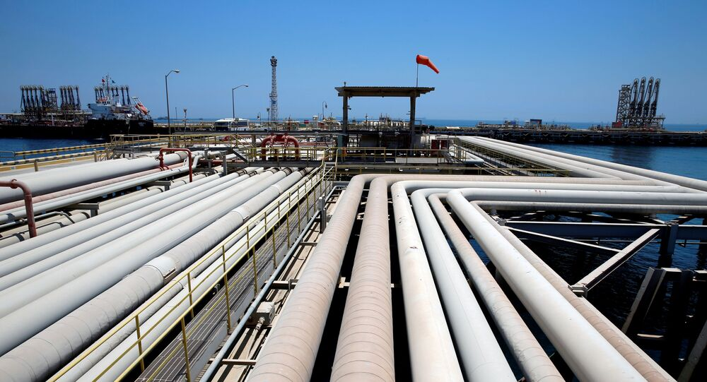 FILE PHOTO: An oil tanker is being loaded at Saudi Aramco's Ras Tanura oil refinery and oil terminal in Saudi Arabia May 21, 2018
