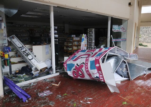 A storefront stands shattered by Hurricane Delta in Cancun, Mexico, Wednesday, Oct. 7, 2020. Hurricane Delta made landfall Wednesday just south of the Mexican resort of Cancun as a Category 2 storm, downing trees and knocking out power to some resorts along the northeastern coast of the Yucatan Peninsula.