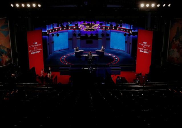 Stand-ins for the candidates and moderator rehearse on the debate stage during technical run-throughs a day ahead of the 2020 vice presidential campaign debate between Republican vice presidential nominee and U.S. Vice President Mike Pence and Democratic vice presidential nominee and U.S. Senator Kamala Harris, on the campus of the University of Utah in Salt Lake City, Utah, U.S., October 6, 2020.