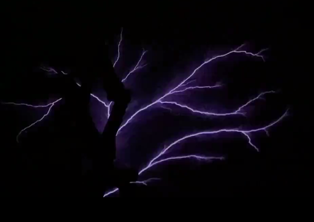 A screenshot from a video featuring the weather phenomenon 'St. Elmo's Fire', captured by a military aircraft from the Number 99 Squadron of the UK Royal Air Force.