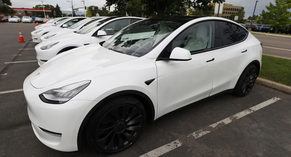 FILE - In this Sunday, 28 June 2020 file photo, a 2020 Model Y electric sports-utility vehicles sit in the parking lot of a Tesla store in Littleton, Colorado. Tesla overcame a seven-week pandemic-related shutdown at its U.S. assembly plant to post a $104 million net profit for the second quarter. (AP Photo/David Zalubowski)
