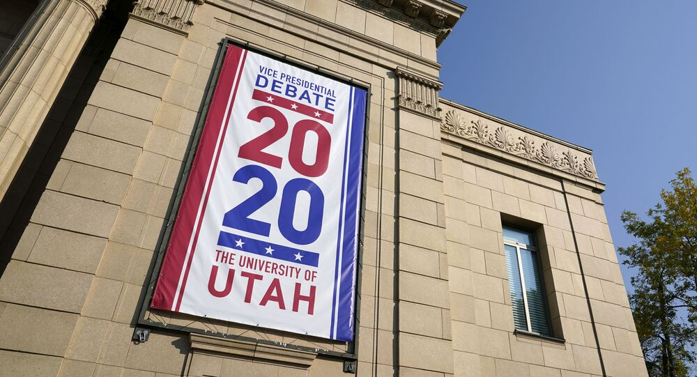 Banners hang from Kingsbury Hall at the University of Utah as preparations take place for the vice presidential debate between Vice President Mike Pence and Democratic vice presidential candidate, Sen. Kamala Harris, D-Calif., Wednesday, Oct. 7, 2020, in Salt Lake City