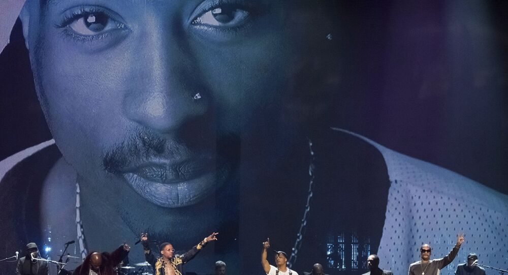Treach, from left, T.I., YG and Snoop Dogg perform a tribute to inductee Tupac Shakur at the 2017 Rock and Roll Hall of Fame induction ceremony at the Barclays Center on Friday, April 7, 2017, in New York.