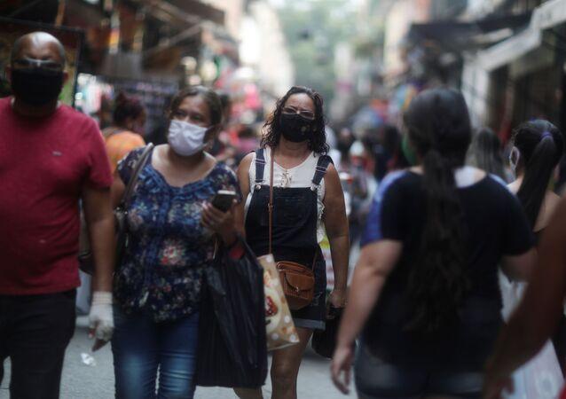 People walk around the Saara street market, amid the outbreak of the coronavirus disease (COVID-19), in Rio de Janeiro, Brazil, October 7, 2020.