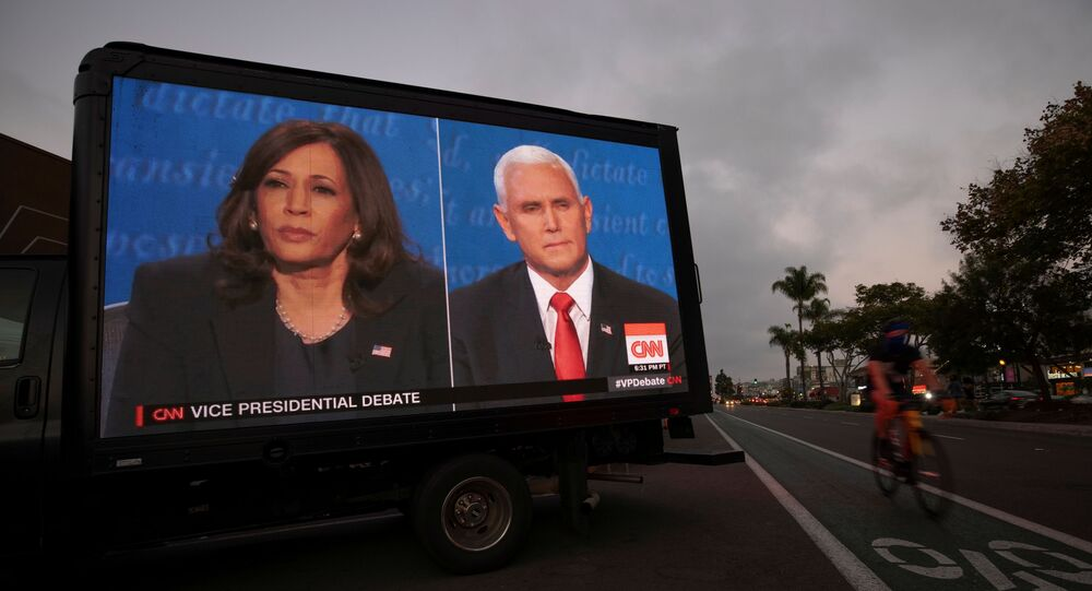 A digital truck broadcasts the debate between U.S. Vice President Mike Pence and Democratic vice-presidential nominee Kamala Harris outside a tavern in San Diego, California, U.S., October, 7, 2020.