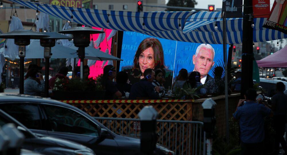 People watch the debate between U.S. Vice President Mike Pence and Democratic vice-presidential nominee Kamala Harris outside a tavern in San Diego, California, U.S., October, 7, 2020.