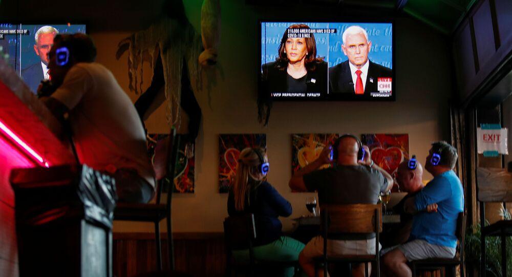 People watch the debate between U.S. Vice President Mike Pence and Democratic vice-presidential nominee Kamala Harris at a tavern in San Diego, California, U.S., October, 7, 2020.