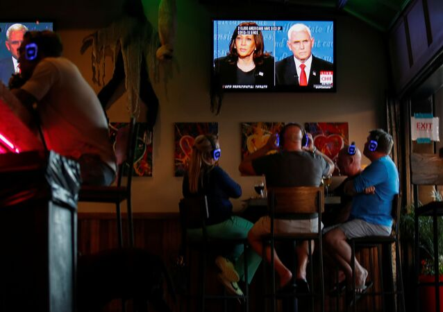 People watch the debate between U.S. Vice President Mike Pence and Democratic vice-presidential nominee Kamala Harris at a tavern in San Diego, California, U.S., October, 7, 2020.