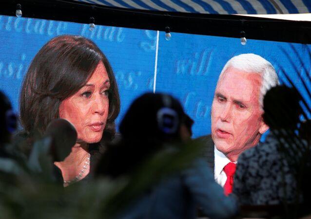 People watch the debate between U.S. Vice President Mike Pence and Democratic vice-presidential nominee Kamala Harris outside a tavern in San Diego, California, U.S., October 7, 2020.