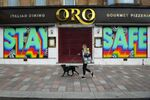 A pedestrian walks past a shuttered restaurant with a mural that reads Stay Safe on it in Glasgow on May 16, 2020, during the novel coronavirus COVID-19 pandemic lockdown