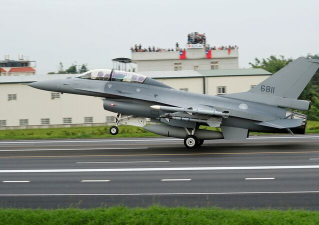 FILE PHOTO: F-16V fighter jet lands on a highway used as an emergency runway during the Han Kuang military exercise simulating the China's People's Liberation Army (PLA) invading the island, in Changhua, Taiwan May 28, 2019