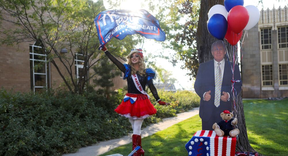 U.S. President Donald Trump's supporter Lady MAGA USA walks waving a flag outside the site of the 2020 vice presidential debate between U.S. Vice President Mike Pence and Democratic vice presidential nominee and U.S. Senator Kamala Harris, at the campus of the University of Utah in Salt Lake City, Utah, U.S., October 7, 2020