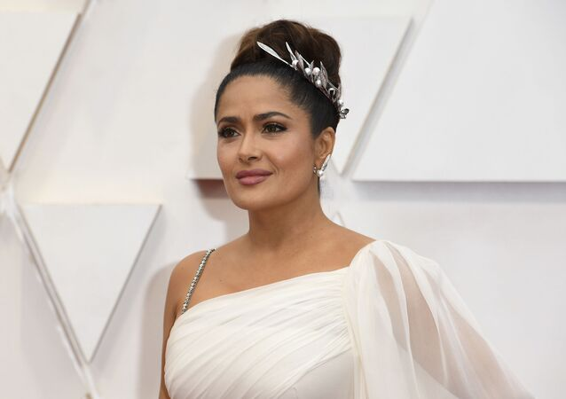 Salma Hayek arrives at the Oscars on Sunday, Feb. 9, 2020, at the Dolby Theatre in Los Angeles