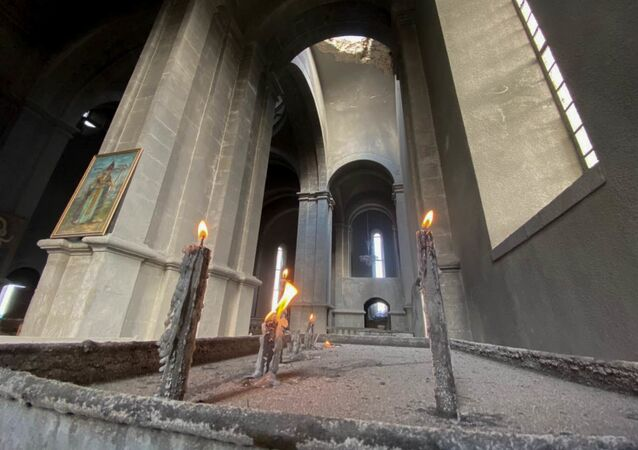 Candles are lit in the damaged Holy Savior Cathedral after the recent shelling, in Shusha, the self-proclaimed Nagorno-Karabakh Republic. A fresh spark in the conflict between Armenia and Azerbaijan in the disputed Nagorno-Karabakh region occurred on September, 27. Yerevan and Baku have both accused each other of violating the 1994 ceasefire and causing civilian casualties.