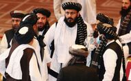 Taliban delegates speak during talks between the Afghan government and Taliban insurgents in Doha, Qatar September 12, 2020.