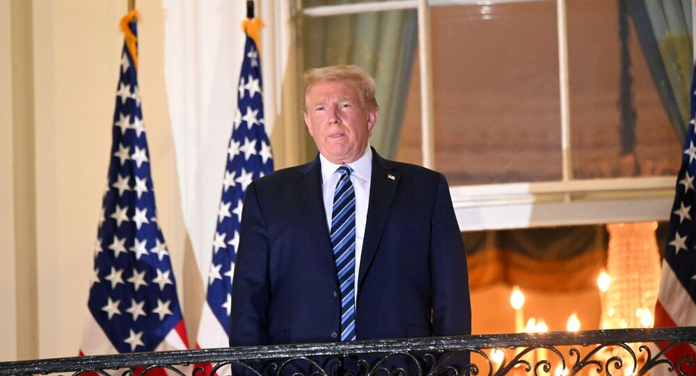 U.S. President Donald Trump poses atop the Truman Balcony of the White House after taking off his protective face mask as he returns to the White House after being hospitalized at Walter Reed Medical Center for coronavirus disease (COVID-19) treatment, in Washington, U.S. October 5, 2020.