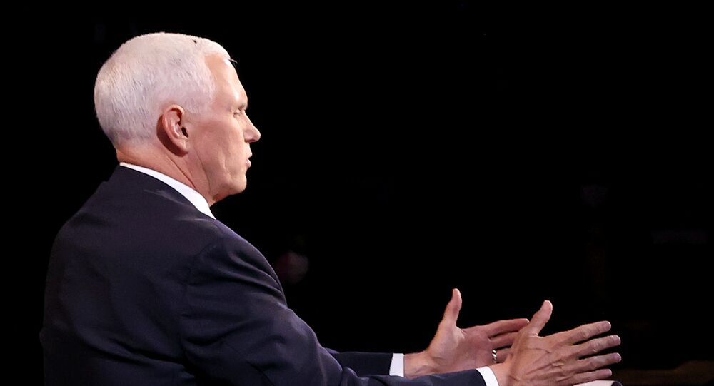 A fly is seen on the head of U.S. Vice President Mike Pence as he takes part in the 2020 vice presidential debate with the Democratic vice presidential nominee and U.S. Senator Kamala Harris (not pictured) on the campus of the University of Utah in Salt Lake City, Utah, U.S., October 7, 2020