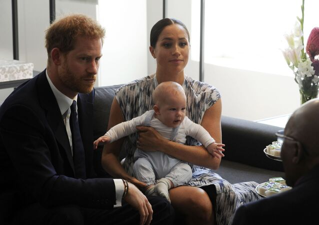 Britain's Prince Harry and Meghan, Duchess of Sussex, holding their son Archie, meet with Anglican Archbishop Emeritus, Desmond Tutu in Cape Town, South Africa, Wednesday Sept. 25, 2019.