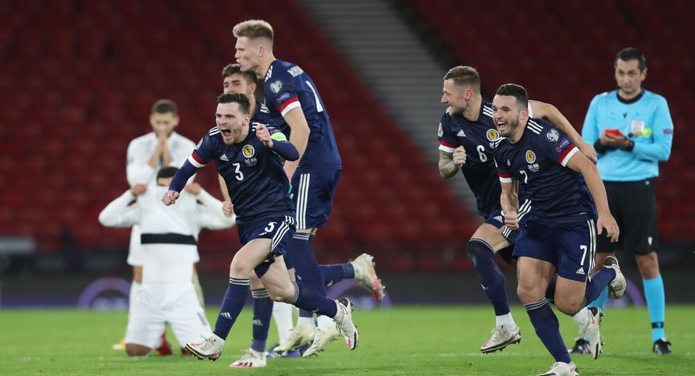 Scotland's Andy Robertson and team-mates celebrate after beating Israel in a penalty shootout on 8 October 2020.