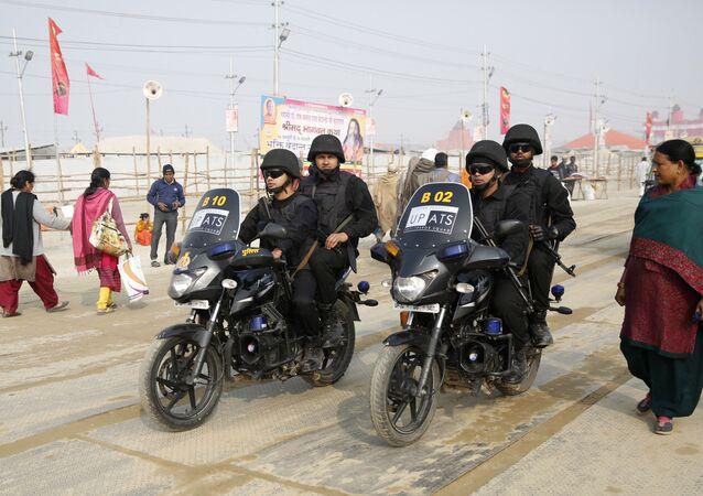 Uttar Pradesh police Anti-Terrorism Squad patrol on motorbikes at the spiritual-cleansing Kumbh Festival in Allahabad, India, Monday, Jan.14, 2019