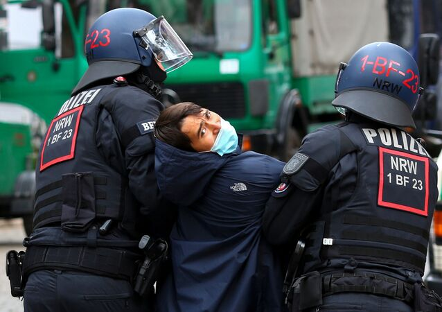 Police officers detain a person during a protest near the squatted left-wing housing project Liebigstrasse 34, which is facing eviction, in Berlin, Germany, October 9, 2020