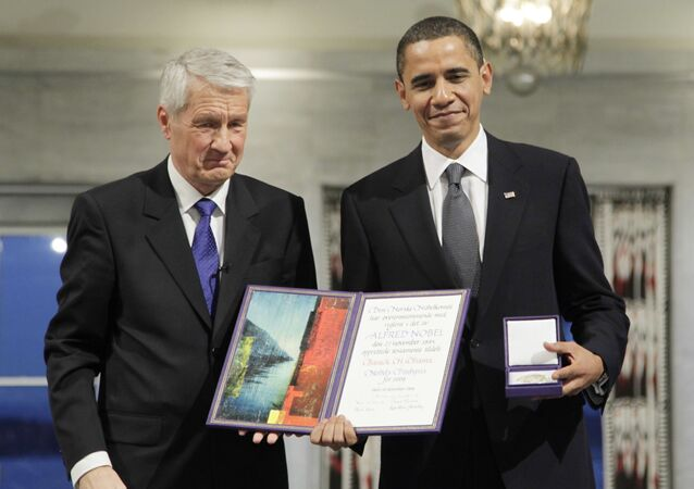 President and Nobel Peace Prize laureate Barack Obama poses alongside Nobel committee chairman Thorbjorn Jagland in 2009.