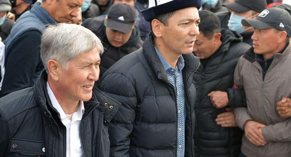 Former Kyrgyz President Almazbek Atambayev (left)