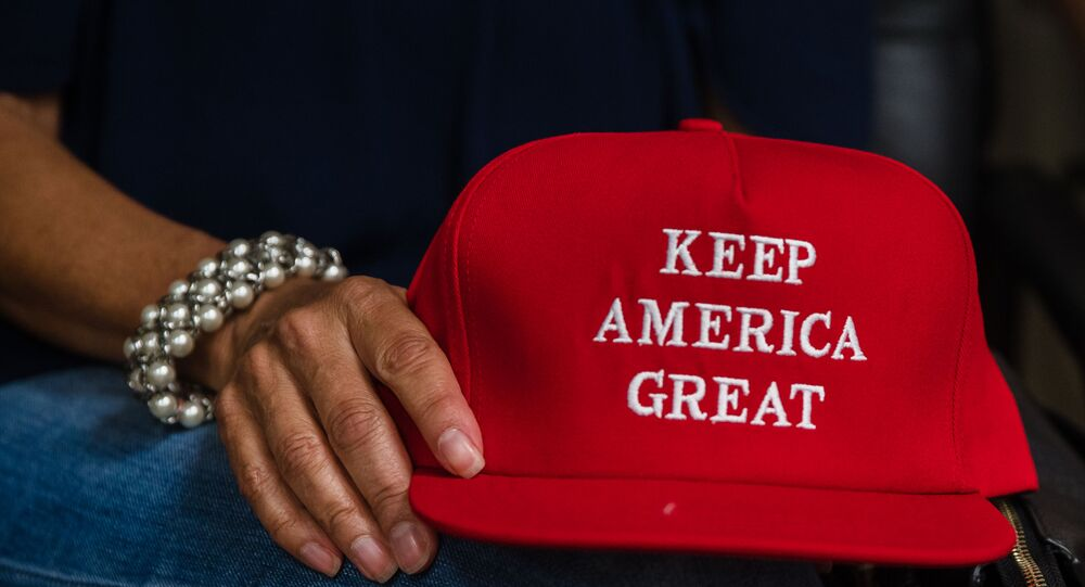 Deborah Palomba holds a Keep America Great hat as she watches US President Donald Trump acceptance speech for the Republican Party nomination for reelection during the final day of the Republican National Convention on TV in the office of San Diego County's Republican Party in Rancho Bernardo, California on August 27, 2020