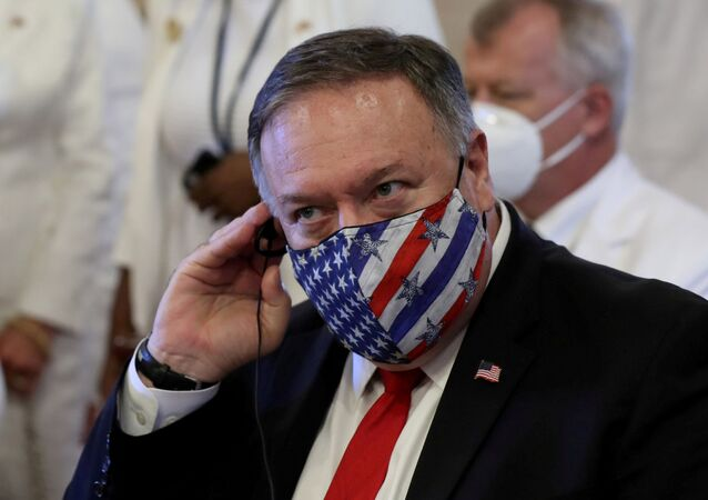 U.S. Secretary of State Mike Pompeo adjusts his earphones during a Te Deum as part of the swearing-in ceremony of Dominican Republic's new President Luis Abinader in Santo Domingo, Dominican Republic August 16, 2020.