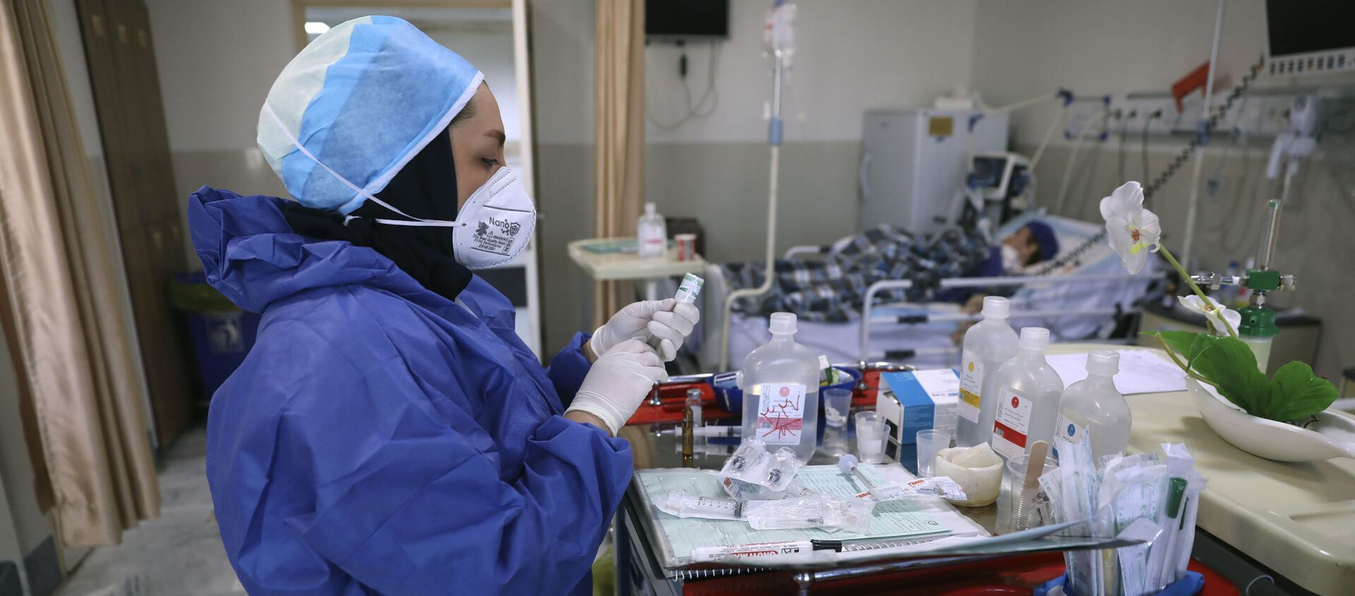 In this Tuesday, June 16, 2020, photo, a nurse prepares medicines for COVID-19 patients at the Shohadaye Tajrish Hospital in Tehran, Iran. After months of fighting the coronavirus, Iran only just saw its highest single-day spike in reported cases after Eid al-Fitr, the holiday that celebrates the end of Ramadan.  - Sputnik International, 1920, 29.04.2021