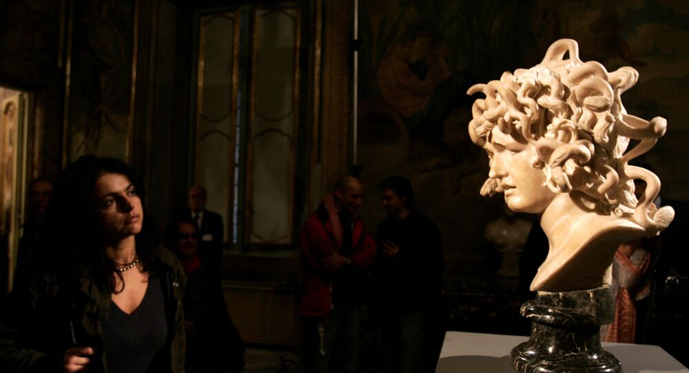 A visitor looks at a marble bust, Bust of Medusa, made by Italian sculptor Gian Lorenzo Bernini between 1644 and 1648, during its inauguration at Rome's Capitolini Museum after its restoration, Wednesday, Nov. 22, 2006. The bust, Bernini's depiction of the Greek mythological character Medusa, is considered one of the most original interpretations of the female myth whose gaze could turn people to stone.