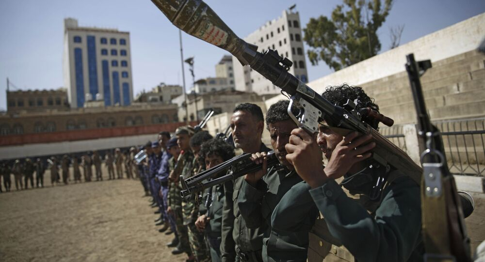 Houthi rebel fighters display their weapons during a gathering aimed at mobilizing more fighters for the Iranian-backed Houthi movement, in Sanaa, Yemen, Thursday, Feb. 20, 2020. The Houthi rebels control the capital, Sanaa, and much of the country's north, where most of the population lives. They are at war with a U.S.-backed, Saudi-led coalition fighting on behalf of the internationally recognized government.