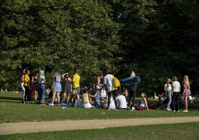 A group of people gather in Hyde Park, in London, Sunday, Sept. 13, 2020. From Monday, social gatherings of more than six people will be banned in England — both indoors and outdoors — and Boris Johnson hinted that such restrictions will potentially remain in place until or through Christmas.