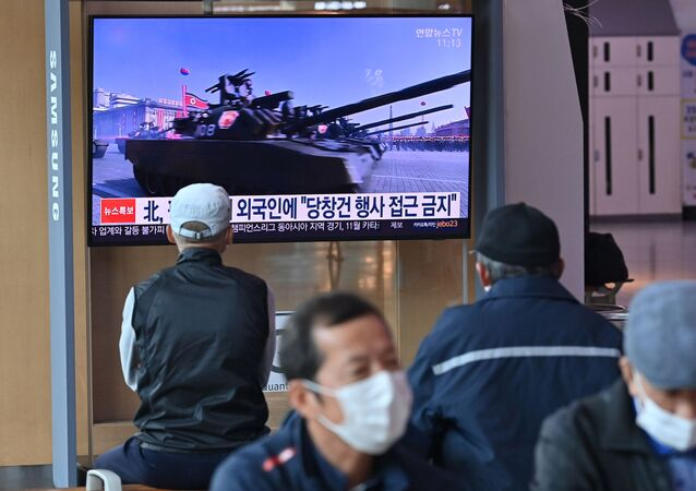 People watch TV news broadcasting file footage of a military parade of North Korean soldiers and weapons, at a railway station in Seoul on 10 October 2020. Nuclear-armed North Korea was expected to parade its latest and most advanced weapons through the streets of Pyongyang on 10 October, as the coronavirus-barricaded country celebrated the 75th anniversary of leader Kim Jong-un's ruling party.