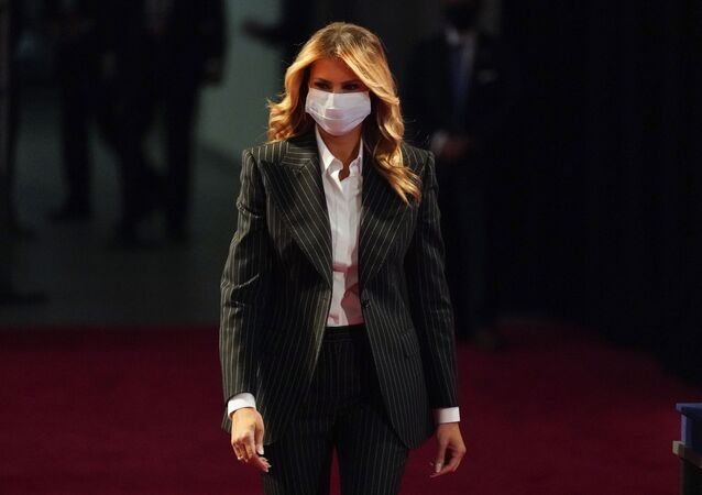 In this Sept. 29, 2020, file photo, first lady Melania Trump, wearing a facemask, walks towards her seat for the during the first presidential debate Tuesday, Sept. 29, 2020, at Case Western University and Cleveland Clinic, in Cleveland, Ohio